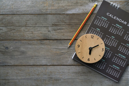 clock and calendar on table